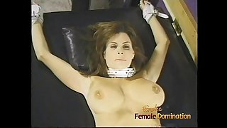 Charming brunette writhing with big naturals gets whipped by two hot dominas